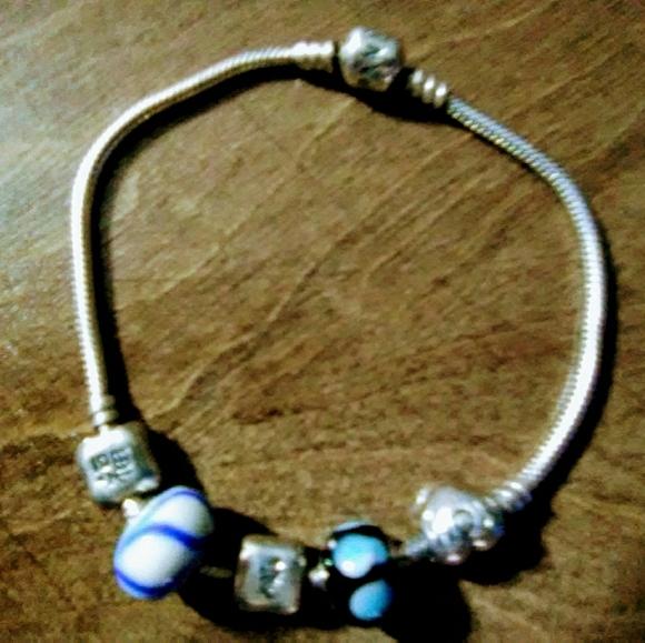 Pandora Jewelry - Pandora charm bracelet with 3 charms 1 says mom